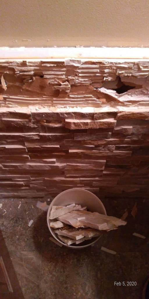 Ledgestone wall in small bathroom