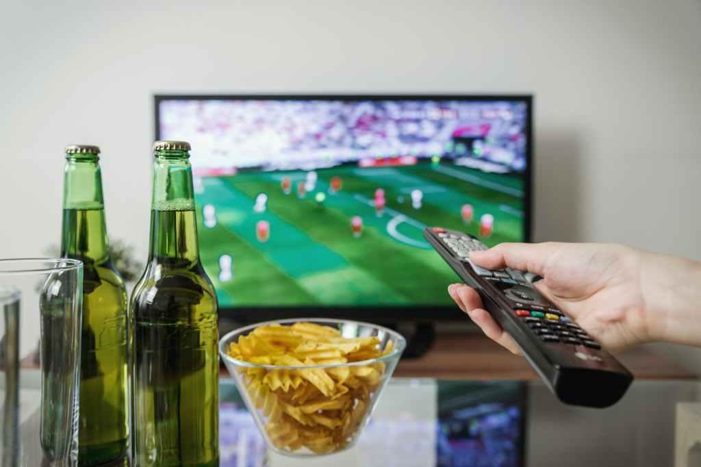 Sports fan watching TV