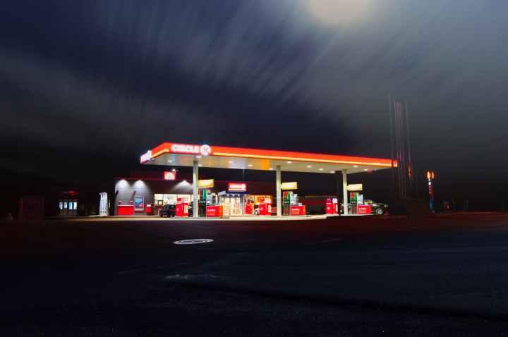 blur dusk evening gas station
