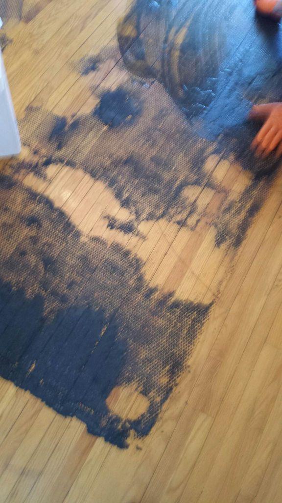 scrubbing underpad from hardwood floor