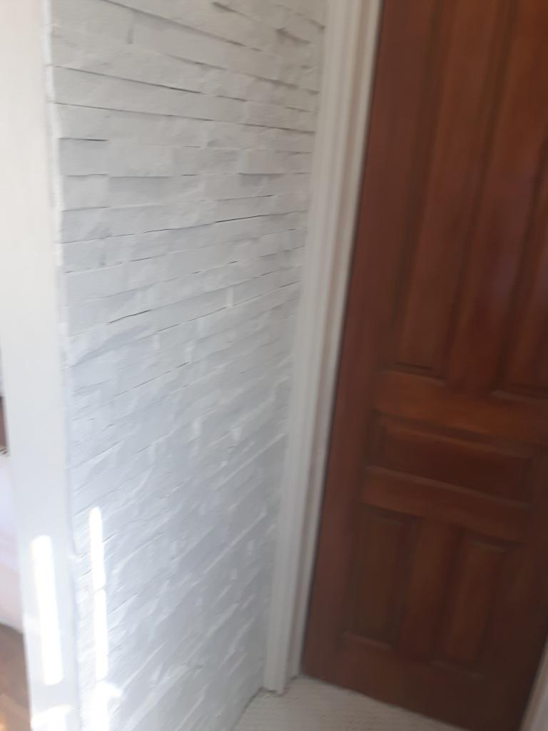 painted ledgestone wall